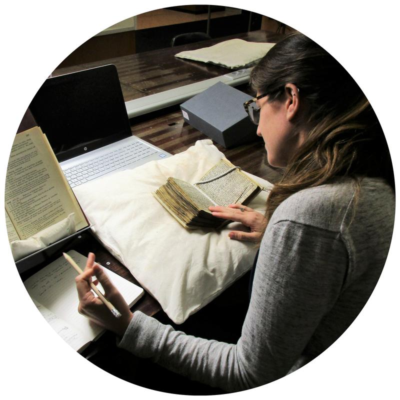 Image of a Marco student examining a manuscript.