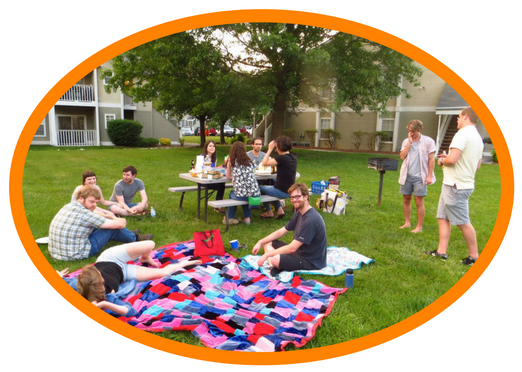 Image of various Marco students and instructors in the Summer Latin program attending a picnic in an outdoor space.