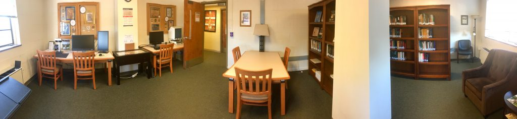 An image of the Riggsby library and reading room showing tables, chairs, and bookshelves