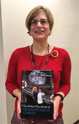 Heather Hirschfeld holding Oxford Handbook